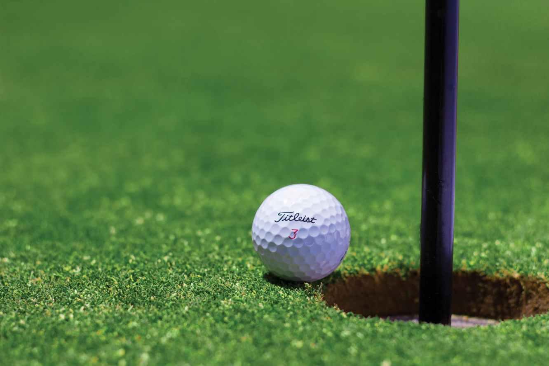 Golf Ball Representing Golf Games